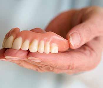 Dentures Dentist Dr. John Aurelia Achieving cosmetic results with dentures in Rochester Hills