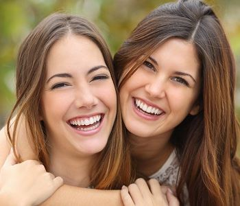 women smile with beautiful teeth from John L. Aurelia, DDS, PLLC