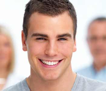 Teeth Whitening Dr. John Aurelia Rochester Hills patients can use teeth whitening strips to brighten their smiles