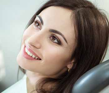 Cosmetic Dentist in Rochester Hills Dr. John Aurelia Dentist in Rochester, MI describes dental treatments including cosmetic restorations