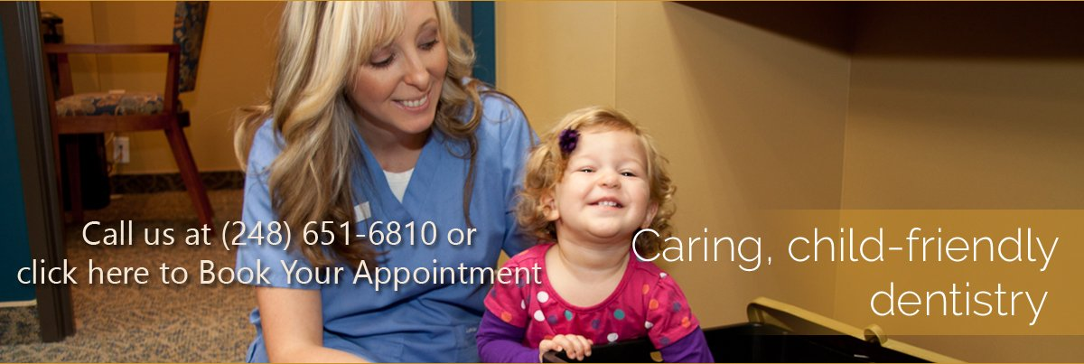 Dentist Rochester Hills - Smiling Girl and staff
